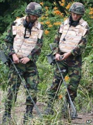 South Korean soldiers search for land mines near the demilitarized zone that separates the two Koreas in Yeoncheon, Aug. 1, 2010