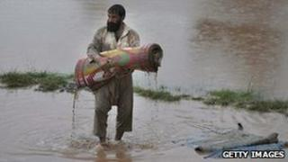 A flood survivor in a waterlogged area of Nowshera
