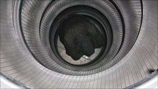 Man hiding in tyre