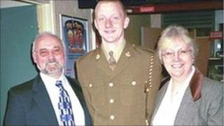 Bombardier Samuel Robinson with his parents Dennis and Alison