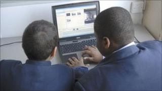 pupils using laptop