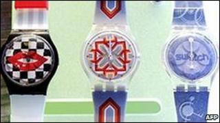 Three colourful swatch watches