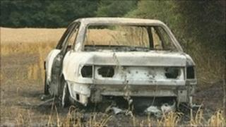 Burnt out getaway car used in raid on jewellers