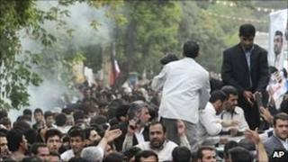 Smoke near the car in which Mahmoud Ahmadinejad (r) was travelling to Hamedan 4 August, 2010