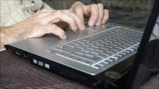 A man uses a laptop computer