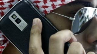 A Saudi man speaks on his BlackBerry