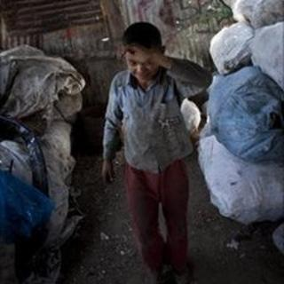 Saer al-Rashayda collects plastic from a landfill in Gaza City, July 2010