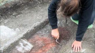 An archaeologist working at the site