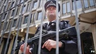 An armed police officer outside the US embassy in London