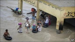 Victims of the floods in Pakistani wait to be evacuated in Sanawan near Multan in central Pakistan on Thursday