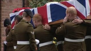Colleagues carry Staff Sgt Brett Linley's coffin into the church in Bournville