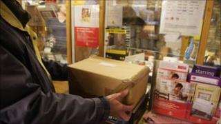 Parcel being weighed at a Post Office counter