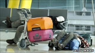 Passengers wait at Madrid Barajas airport on April 20, 2010, after some planes remain grounded as a result of the volcanic eruption in Iceland.