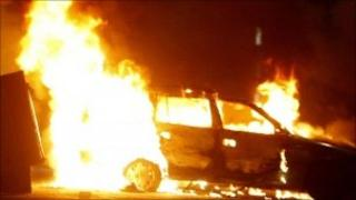 Car on fire during rioting in the Ardoyne