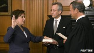 Supreme Court Chief Justice John Roberts (R) administers the Constitutional Oath of office to Elena Kagan (L) at the Supreme Court - 7 August 2010