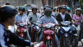 File image of motorcycle riders in Hanoi, Vietnam