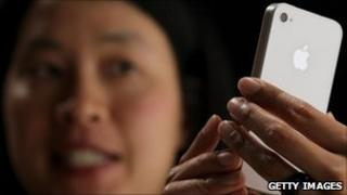 iPhone 4 being demonstrated, Getty