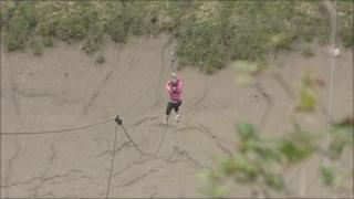 Woman zip sliding