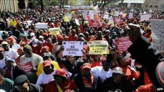 Thousands of South African civil servants march through Pretoria on 10 August 10 2010 on a one-day strike to press for better salaries