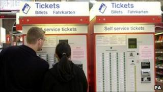 Commuters at rail ticket machines