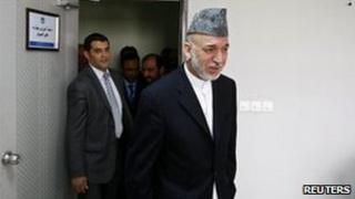 Afghan President Hamid Karzai arrives for his speech to the Civil Services Institute in Kabul, 7 August