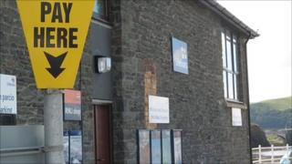 A pay and display sign near Aberystwyth lifeboat station