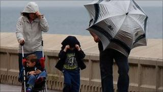 Family in Scarborough in bad weather