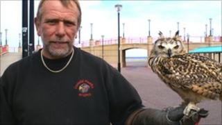 Mike Espley with one of the owls he uses to scare gulls