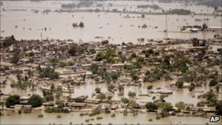 Houses half submerged in floodwater in Ghaus Pur near Sukkur, in Pakistan's Sindh province