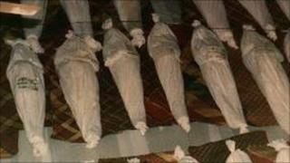 Bodies of Muslims killed in 1990