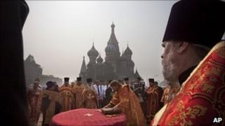 Russian priests hold a service in Red Square, Moscow, August 2010