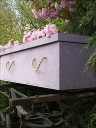 Newspaper coffin