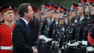 David Cameron inspects Officer Cadets during their passing out ceremony