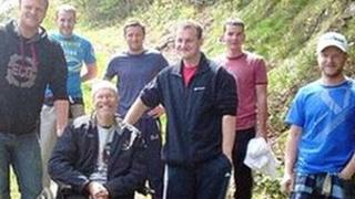 Martin Williams in his wheelchair with supporters who will carry him up Snowdon
