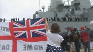 Child welcomes home HMS Ark Royal with banner