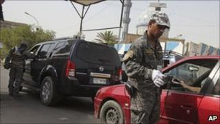 Police officers at a Baghdad checkpoint, file image