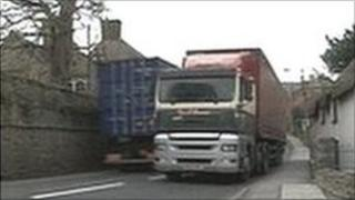 A lorry drives through Chideock