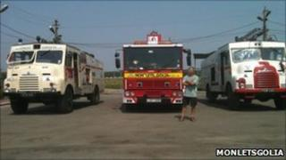 Red fire engine and two Green Goddesses
