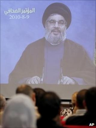 Hezbollah leader Hassan Nasrallah speaks through a video link during a press conference in Beirut. Aug 9 2010