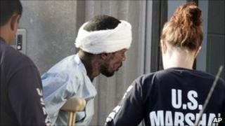 Police escort a Somali national into a federal court