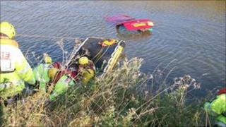 Firefighters rescue man from sinking car