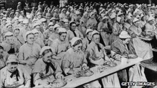 Dinner time at a workhouse