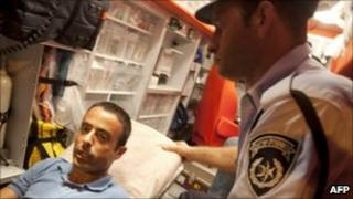 Nadim Injaz in an ambulance after having been handed over to the Israeli authorities, 17 August 2010