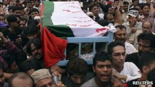 Supporters carry the coffin of Raza Haider after he was shot dead in Karachi