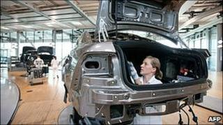 Worker on German carmaker Volkswagen's production line