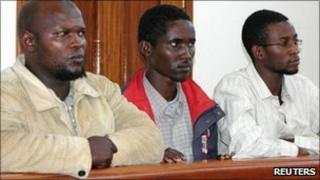 Kenyans Idris Magondu (left), Hussein Hassan and Mohammed Adan Abdow (right), stand in the dock at the Nakawa court in Kampala 30 July 2010