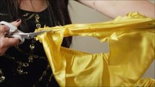 Woman cutting up underwear