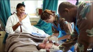 Army medics assist a patient at the labour ward of the King Edward VIII Hospital in Durban