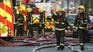 Firefighters at the scene of a fire in Peckham, south- east London