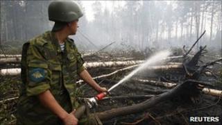 Russian soldier fights fires in village of Kartanosovo in Ryazan region